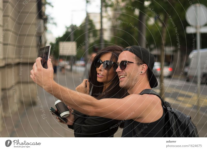 Cheerful friends taking photos of themselves on smart phone selfie friendship women group people internet street fun happiness cheerful smiling lifestyle usrban