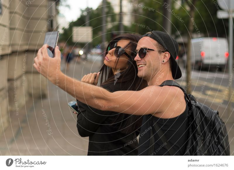 Young couple taking selfies friendship women group people internet street fun photo happiness cheerful smiling lifestyle usrban spring summer joy smart phone