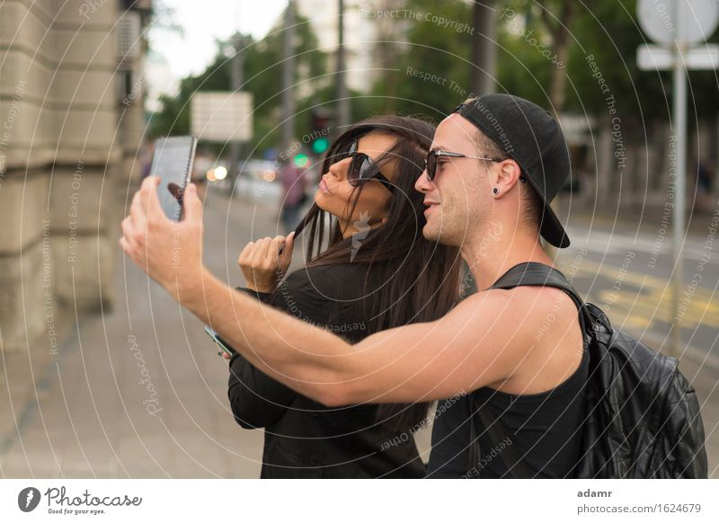 Two cheerful friends taking photos of themselves on smart phone selfie friendship women group people internet street fun happiness smiling lifestyle usrban