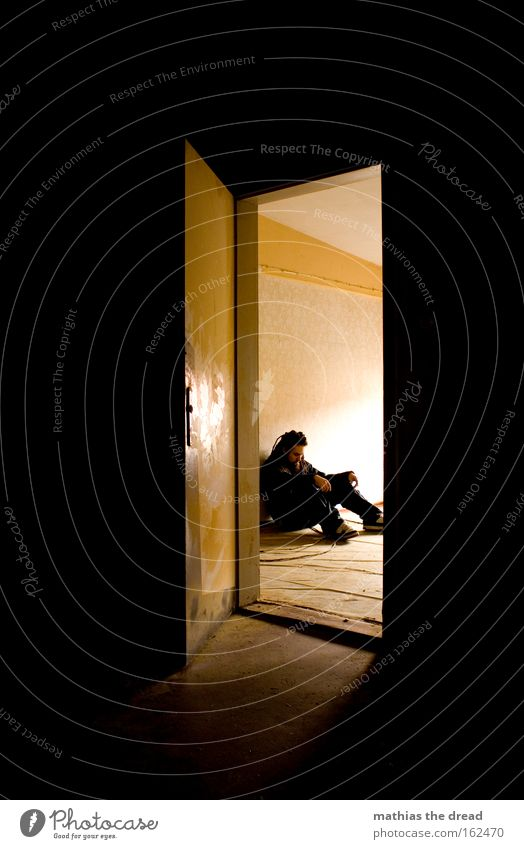 Human being Man Loneliness Sadness Bright Room Door Sit Grief Transience Derelict Meditative Distress Insight Opening