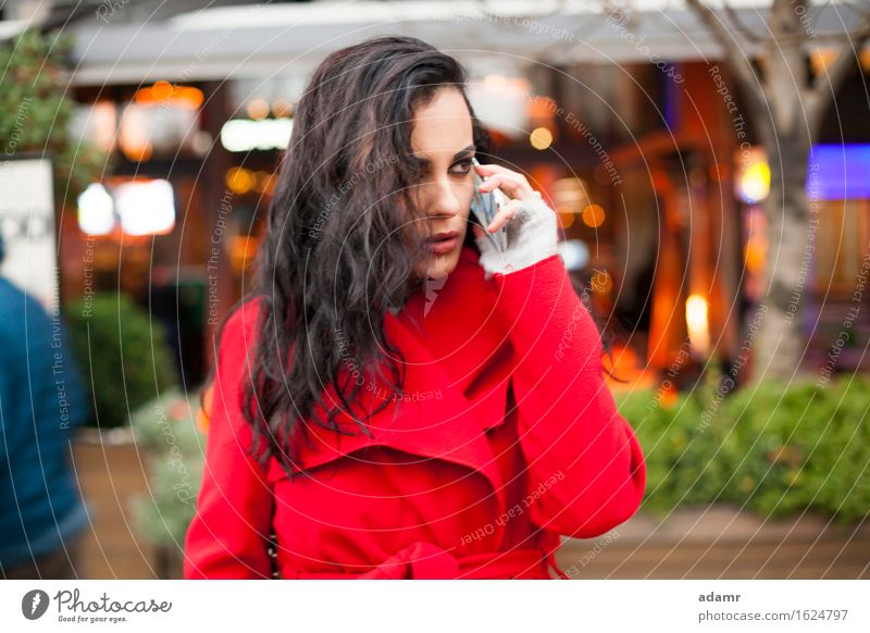 Woman in red coat speak on mobile phone woman woriew looking smartphone person cold winter female telephone cell communication people wireless cellphone hand
