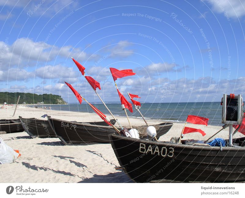 Flags in the wind Beach Watercraft Clouds Ocean Rügen Wind Sky