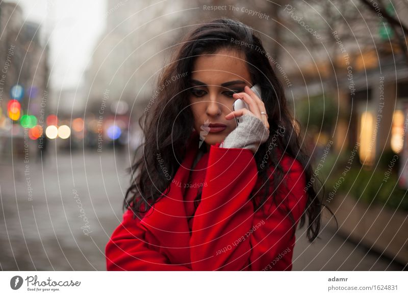 Woman in red coat with mobile phone in hands, smartphone, urban scene woman smile smiling lifestyle girl person cold winter female technology telephone cell