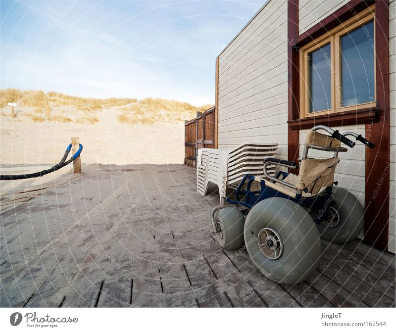 The sun seat in the evening of life Beach Beach dune Sand Restaurant Plank Lanes & trails Wheelchair Relaxation North Sea Ameland Sky Railing Coast Transience