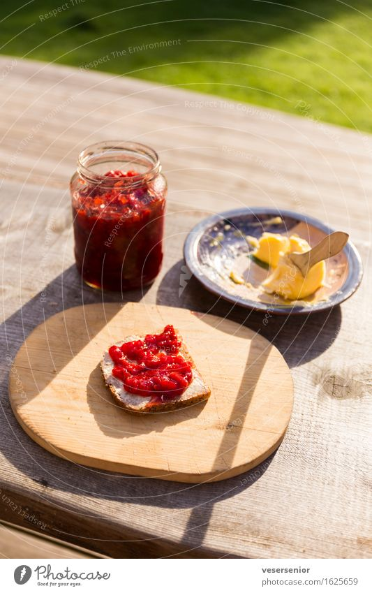 Swedish summer fueh in the morning Bread Jam Butter Breakfast Chopping board Eating To enjoy Simple Delicious Sweet Anticipation Modest Idyll Calm Thrifty