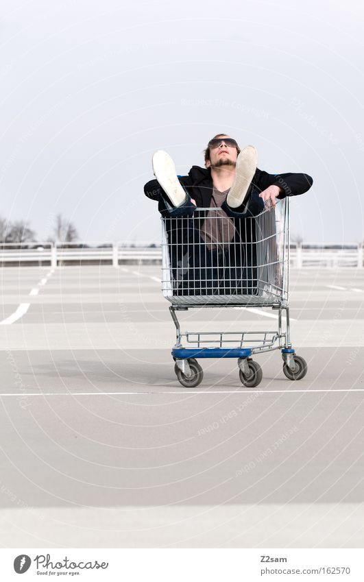 special offer Human being Man Easygoing Cool (slang) Parking lot Shopping Trolley Relaxation Sit Line Work and employment chill