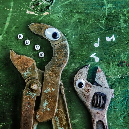 A pair of pliers and a screwdriver with eyes communicate with each other. He whistles for notes and you call silence! Work and employment Profession