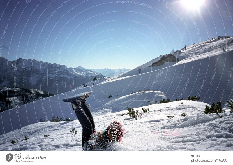 Sun Mountain Snow Sports Action Beautiful weather To fall Snowcapped peak Pain Sudden fall Snowscape Blue sky Snowboard Adversity Winter's day Hurt