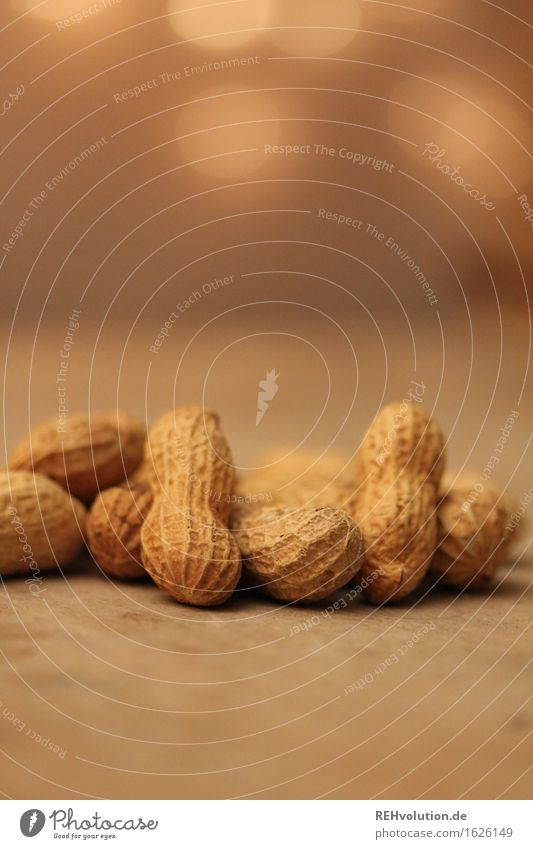 peanuts Food Nut Peanut Lie Crowd of people Multiple Heap Table Christmas & Advent Moody Brown Beige Colour photo Interior shot Copy Space top Artificial light