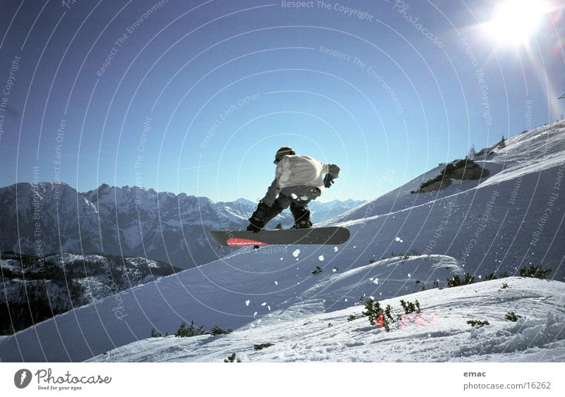 Sun Snow Sports Flying Jump Action Tall Speed Beautiful weather Touch Posture Snowcapped peak Cloudless sky Downward Blue sky Snowboard
