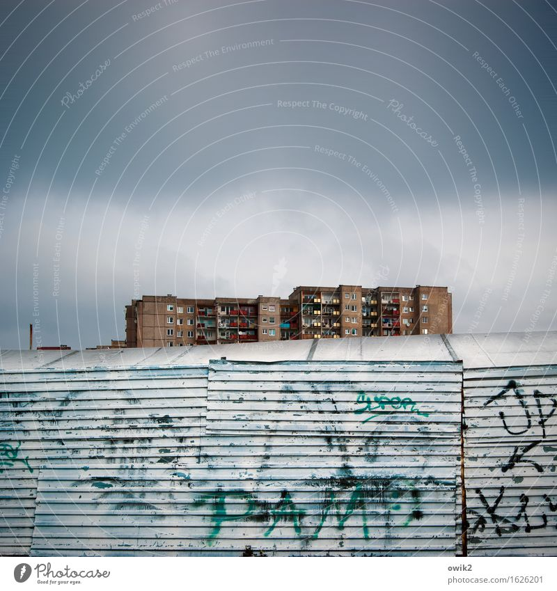 Clouds House (Residential Structure) Dark Architecture Wall (building) Graffiti Building Wall (barrier) Metal Vantage point Tall Climate Simple Threat Fence
