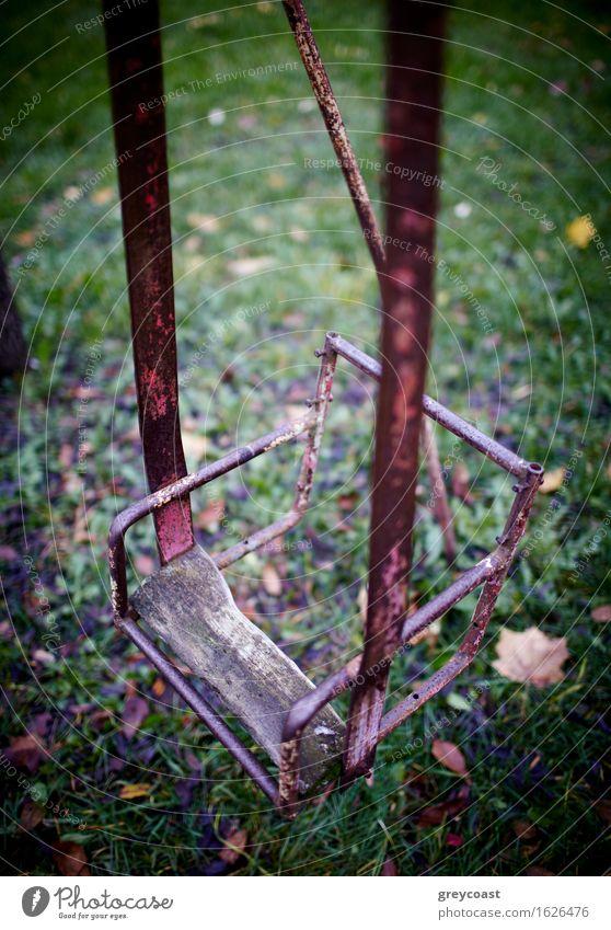 The broken child's swing. Garden Infancy Autumn Park Forest Old Sadness Loneliness Seesaw teeter-totter vintage yard Backyard damage Vertical solitude