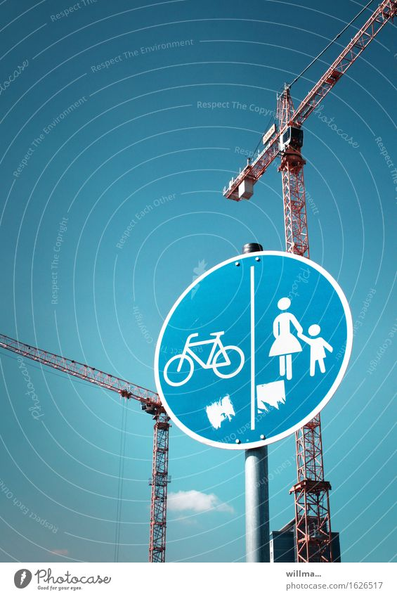 Traffic sign for pedestrians and cycle path with cranes in the background Road sign Footpath Cycling Pedestrian Crane Deserted 2 cranes Construction site