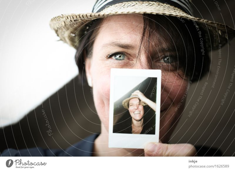 Woman with Polaroid Lifestyle Style Joy Leisure and hobbies Adults Face 1 Human being Hat Straw hat Photography Picture-in-picture Smiling Laughter Friendliness