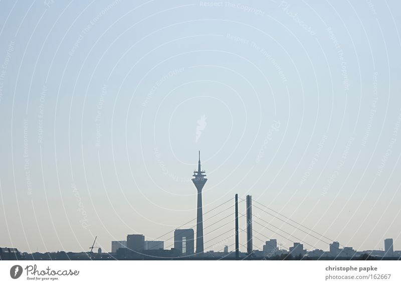 Skyline of Düsseldorf, NRW, Germany Dusseldorf Town High-rise Capital city bridge Sightseeing Rhine Television tower Silhouette City trip Architecture Tower