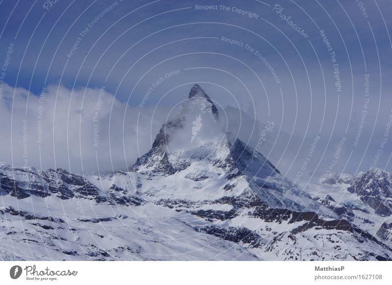 Matterhorn | Zermatt in Switzerland Tourism Adventure Far-off places Sightseeing Winter Snow Winter vacation Mountain Nature Landscape Sky Clouds