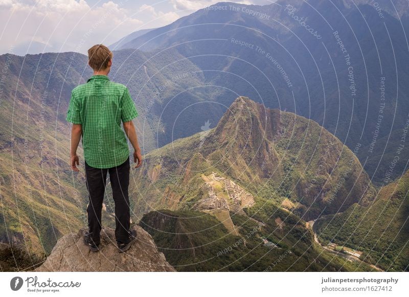 Tourist looking at Machu Picchu Inca city, Peru Vacation & Travel Tourism Mountain Culture Nature Landscape Sky Clouds Rock Town Ruin Street Stone Old Historic