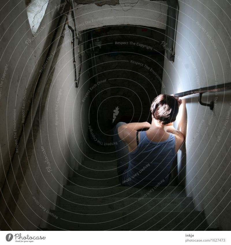 Sad woman sits on basement stairs Living or residing Cellar Cellar stairs Cellar window Woman Adults Life Body Back 1 Human being Crouch Sit Wait Dark Gloomy