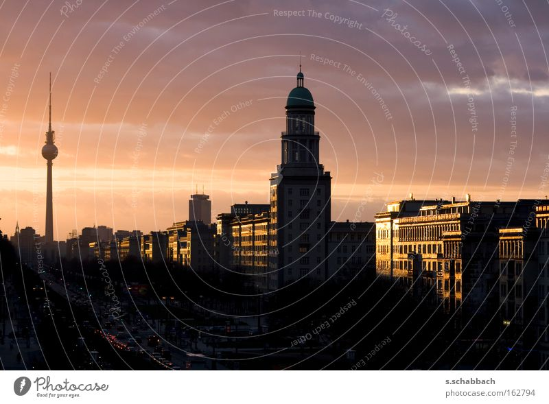 Berlin sunset Sunset Silhouette Frankfurter Tor Television tower Dusk Frankfurter Allee Karl-Marx-Allee Celestial bodies and the universe Long exposure sundown