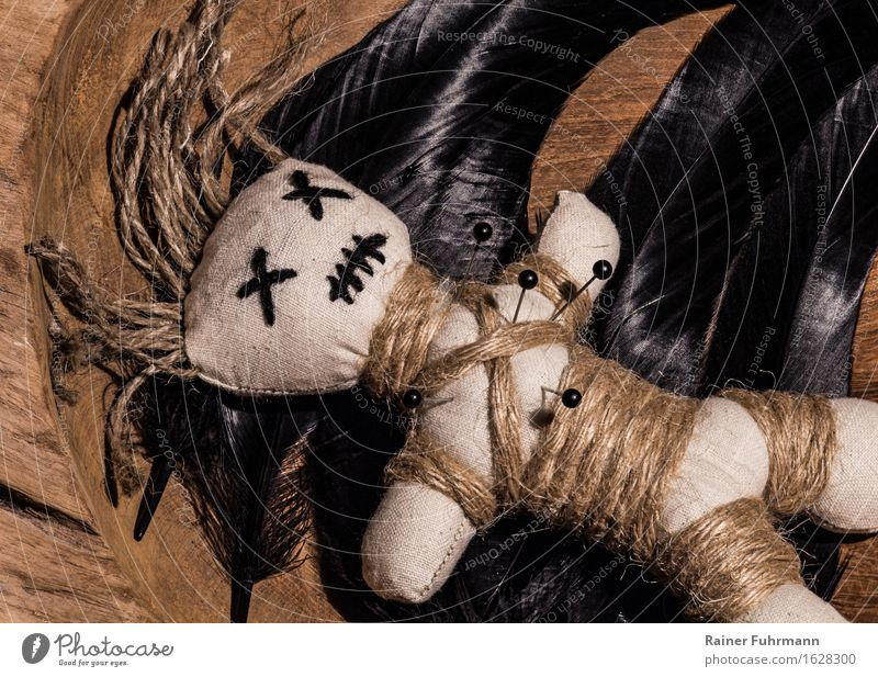 """a voodoo doll at work Event Hallowe'en black mass Puppet theater Culture Sign Touch Dark Creepy Anger Popular belief Animosity Revenge """"Voodoo curse sb./sth."""
