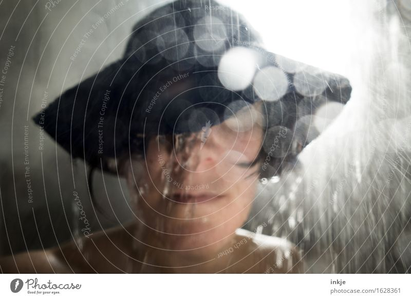 Shower. Shower. Woman Adults Life Face 1 Human being Water Drops of water Bad weather Storm Rain Protective clothing Hat rain hat Blur Splash of water