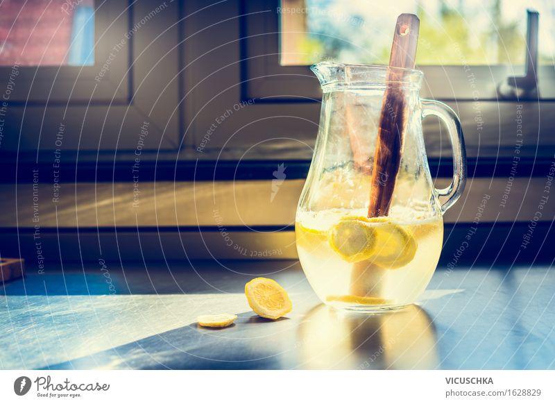 Jug with lemonade on the kitchen table Food Fruit Organic produce Beverage Cold drink Lemonade Juice Longdrink Cocktail Lifestyle Style Healthy Eating