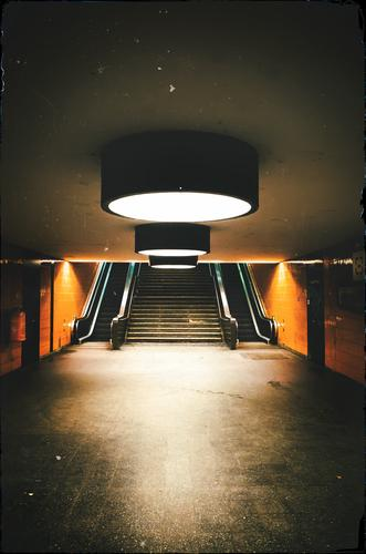 Dark Architecture Lighting Berlin Orange Stairs Mirror Passenger traffic Train station Illumination Commuter trains Escalator Rail transport Underpass