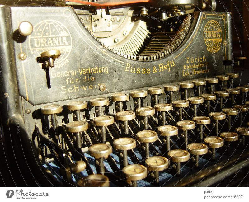Beautiful old thing Keyboard Old Write Typewriter Ancient Antique Urainia from Zurich ink ribbon Colour photo Interior shot Deserted Artificial light