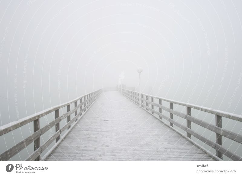 bridge in the fog Footbridge Fog Cold Water Ocean Coast Loneliness Calm Far-off places Hope Winter Ambiguous Meditative Future White Wood Transience