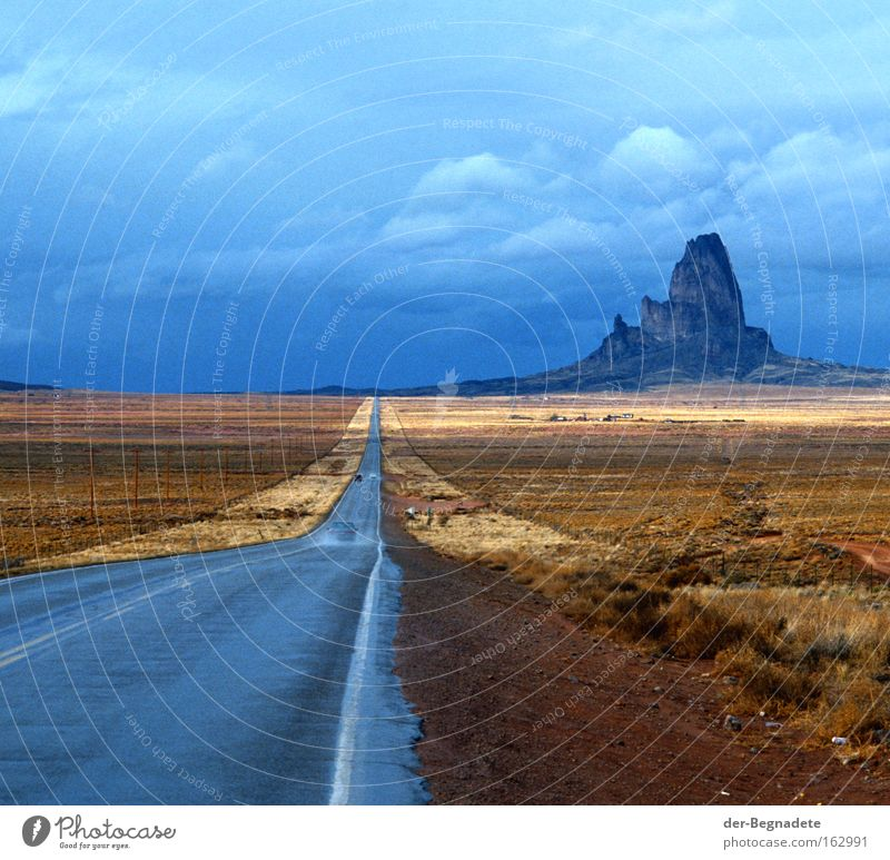 Monument Valley Arizona Street Mountain Rain Clouds Horizon Far-off places Desert Steppe Roadside Vacation & Travel Travel photography Loneliness USA Sky