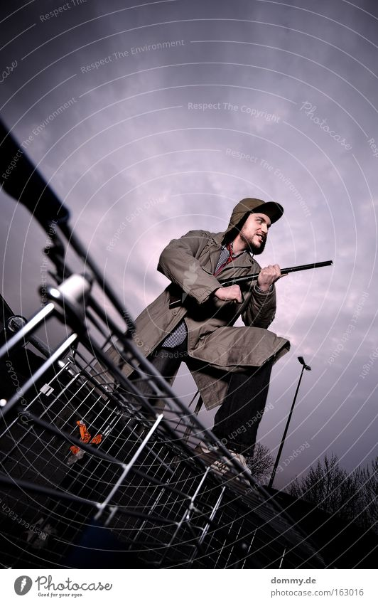 Man Playing Fear Large Dangerous Threat Cap Facial hair Grinning Panic Weapon Hunter Shopping Trolley Profession Shotgun