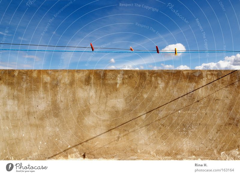 No washing on the line Colour photo Exterior shot Abstract Pattern Deserted Shadow Contrast Sunlight Wide angle Summer Sky Clouds Wall (barrier) Wall (building)