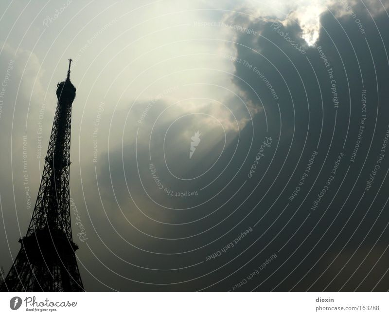 au revoir, Paris! Eiffel Tower Steel Half-timbered facade Back-light Architecture Monumental Tall Massive Transmitting station Iron Tourism Clouds Sun Historic