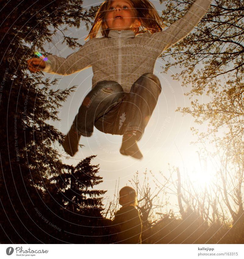 spring-time Child Girl Jump Playing Trampoline Garden Nature Human being Tree Back-light Joy Movement Leisure and hobbies