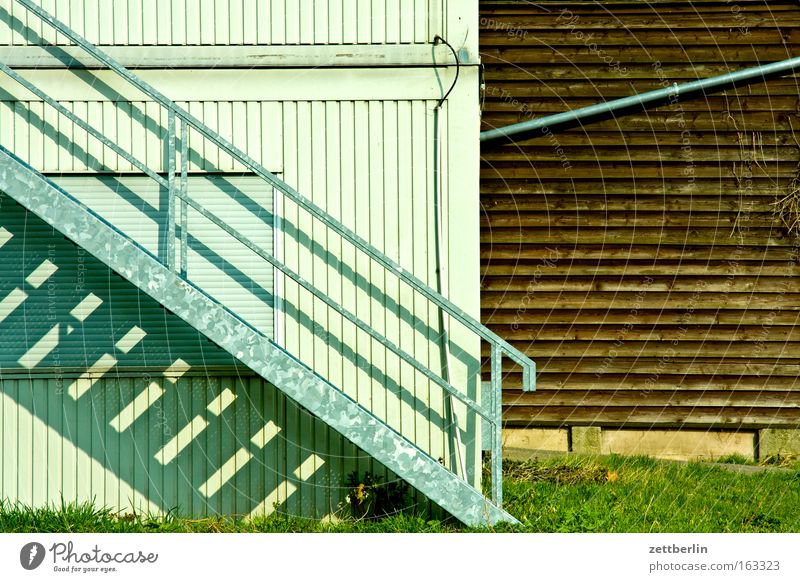 staircase Stairs Career Banister Go up Descent Wall (building) Metal construction Container Closed Wood Scales Building Grass Rain gutter Difference Detail