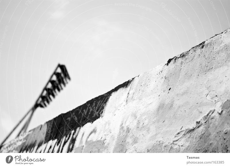 multi-layered Black & white photo Light Wall (barrier) Wall (building) Graffiti Old Rebellious Lighting Spray Interrail Derelict wall park Converse two worlds