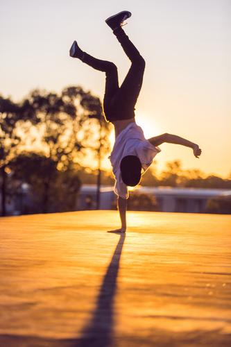 Sunset Artist Human being Youth (Young adults) Summer Young man Joy 18 - 30 years Adults Movement Sports Lifestyle Dance Fitness Street lighting Summer vacation