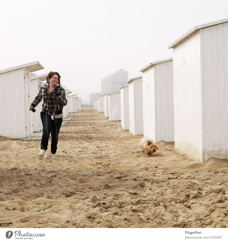 on the straight Joy Happy Freedom Beach Ocean Human being Youth (Young adults) 1 Nature Sand Sky Coast North Sea House (Residential Structure) beach houses Pet