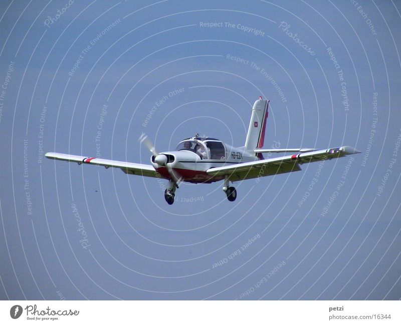 During the landing approach Two-seater Propeller Rotate Landing gear Control device Aviation aerofoil Sky