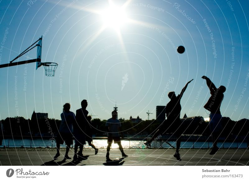 Jumpshot in your Face 6 people Sports Sun Ball Basketball Block Cologne Silhouette Action Blue Sky Spring day Playing Ball sports streetball jumpshot Back-light
