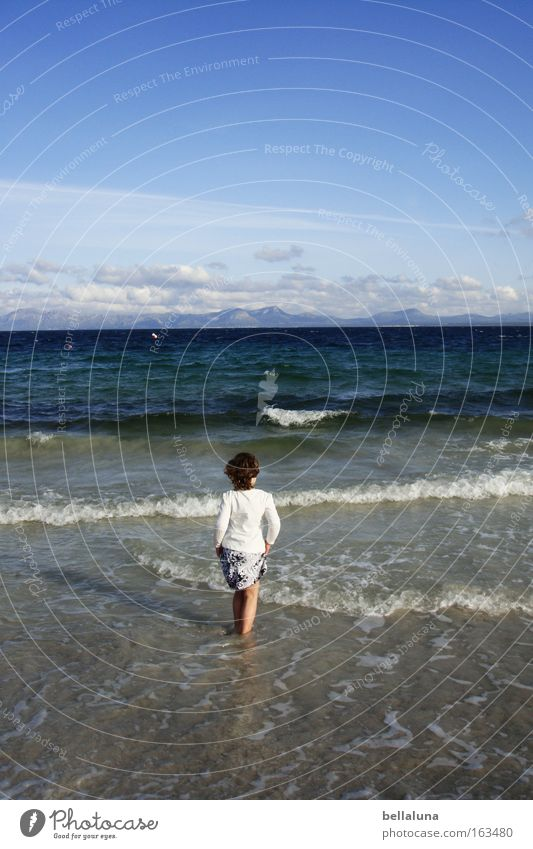 Child Sky Blue White Girl Vacation & Travel Ocean Beach Clouds Waves To go for a walk Surf Blue sky White crest Mediterranean sea Swell