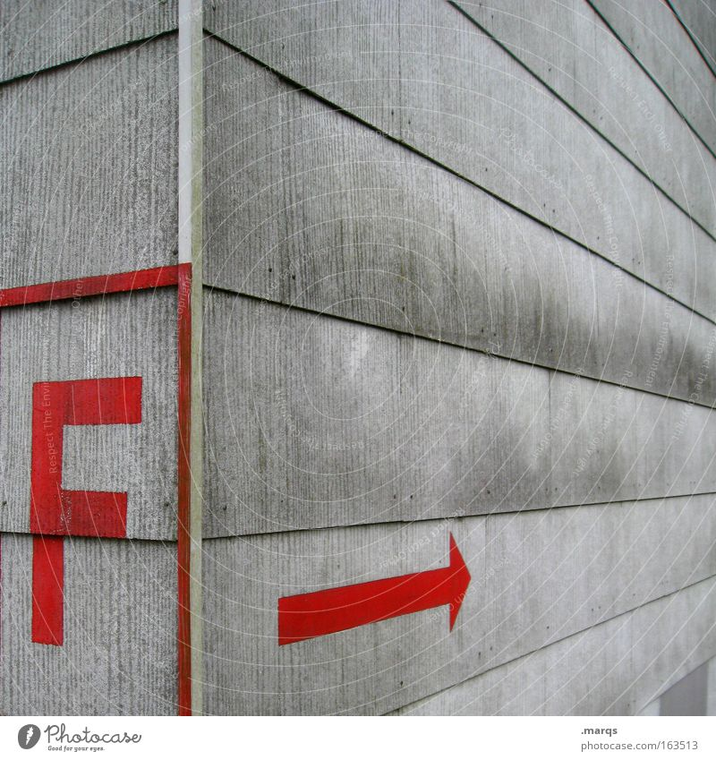 f Colour photo Subdued colour Exterior shot Deserted Copy Space right High-rise Facade Sign Characters Signage Warning sign Arrow Threat Cladding