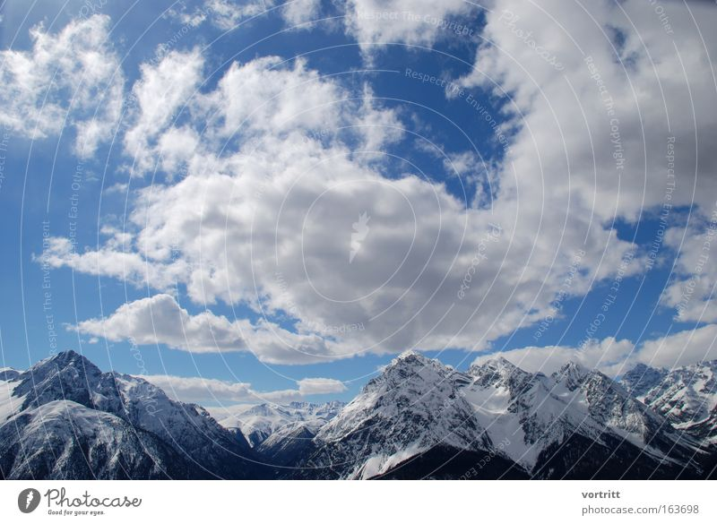 Champagne Powder Colour photo Exterior shot Deserted Copy Space top Day Sunlight Sunbeam Wide angle Skis Ski run Nature Landscape Air Sky Clouds