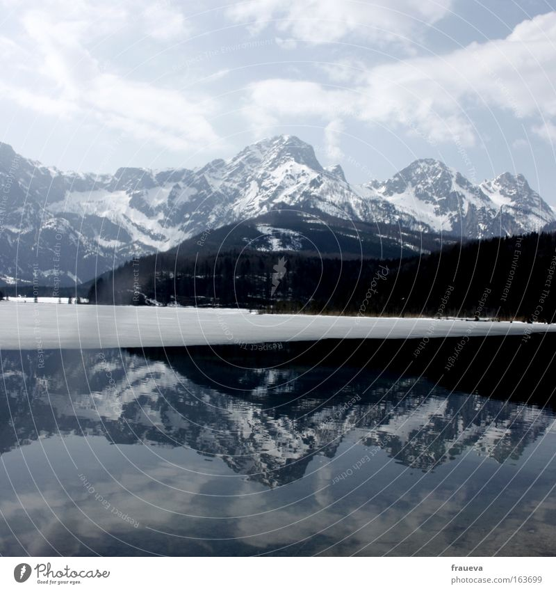 mirroring Colour photo Exterior shot Deserted Day Light Shadow Reflection Sunlight Central perspective Tourism Trip Snow Mountain Hiking Environment Nature