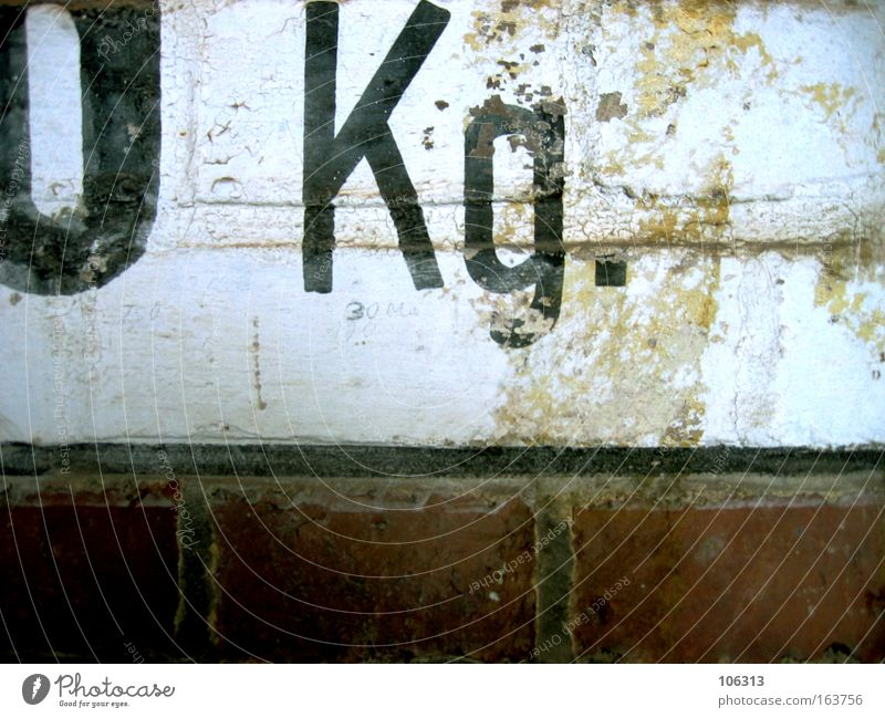 Photo number 118118 0 Kilogram kg Digits and numbers Sign Clue Wall (barrier) Old rocked used Point
