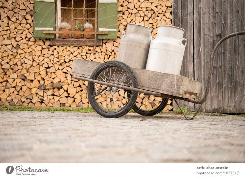 Milk cans on the cart in front of the barn Food Dairy Products Breakfast To have a coffee Beverage Drinking Hot drink Hot Chocolate Coffee Latte macchiato