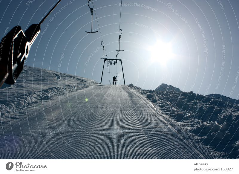 Human being Man Sun Winter Snow Mountain Movement Adults Federal State of Tyrol Back-light Skiing Beautiful weather Cable car Winter sports Ski run