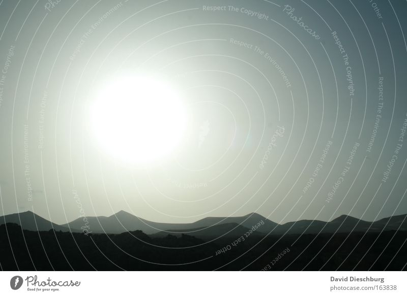 Sunshine over the hills Colour photo Exterior shot Copy Space right Neutral Background Dawn Day Twilight Light Contrast Silhouette Sunlight Sunrise Sunset