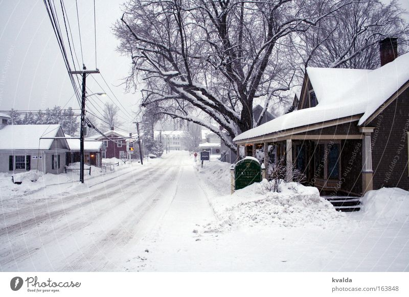 Snowy road Subdued colour Exterior shot Deserted Day Central perspective Winter USA Americas Village Small Town Outskirts House (Residential Structure)