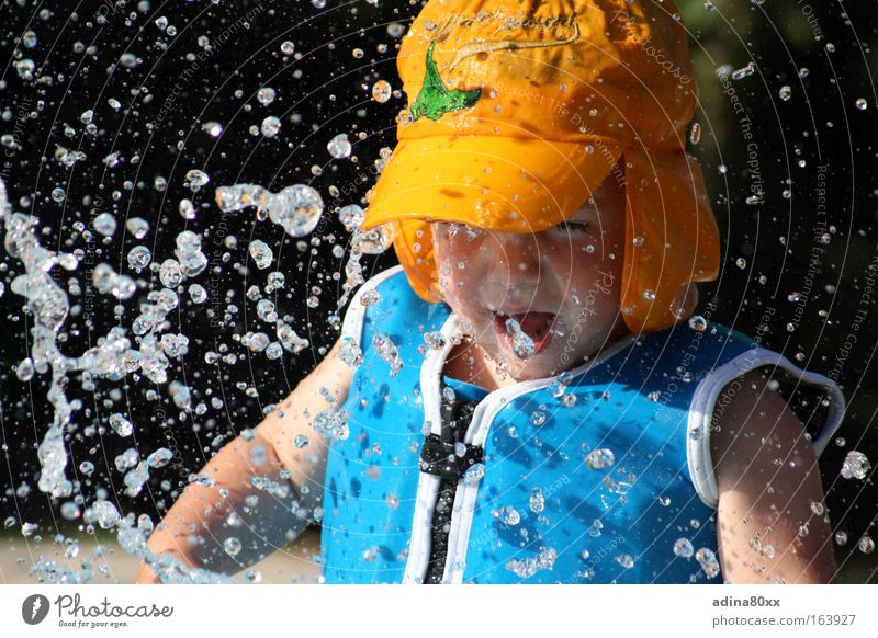 Water experience Colour photo Multicoloured Exterior shot Copy Space left Copy Space bottom Contrast Sunlight Motion blur Downward Closed eyes Playing